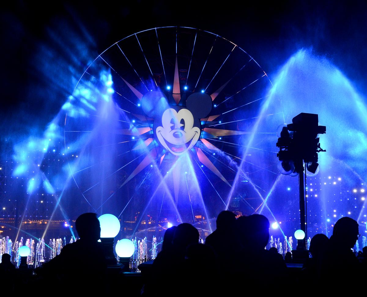 """Invited guests take in the finale of  the launch of Disney California Adventure Park's """"World of Color"""" light show on Wednesday. ///ADDITIONAL INFORMATION: worldofcolor.0521 Ð 5/20/15 Ð BILL ALKOFER, - ORANGE COUNTY REGISTER -  Disney California Adventure Park  unveiled its new """"World of Color"""" light show to celebrate their 60th anniversary on Wednesday."""